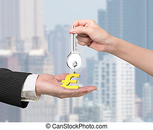 Woman hand giving key pound symbol keyring to man hand