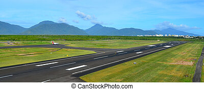 Cairns Airport runway in Queensland AustraliaThe airport is...