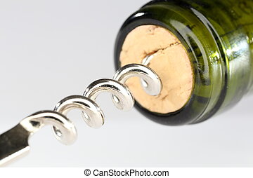 cork screw - wine bottle with cork screw on grey background