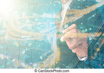 Double Exposure of Businessman writing with Building...