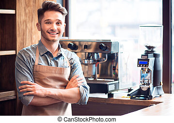 Pleasant waiter working in the cafe - With positivity in...