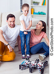 Positive family playing on the floor with his daughter - We...