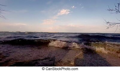 Small wave breaking on camera shot .