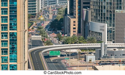 Aerial view of a highway intersection in Dubai, UAE, at day time with traffic timelapse.