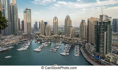 Beautiful aerial top view day to night timelapse of Dubai...