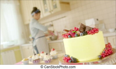 Home made cake and pastry chef - Shot of a big cake with...