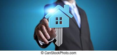 Businessman real estate - Businessman holding digital key...