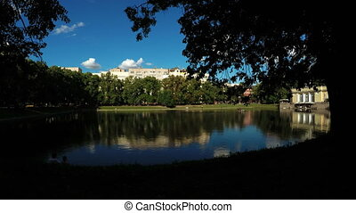 City pond among trees - Panorama Chistye Prudy in Moscow in...