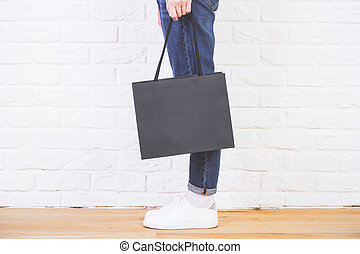 Shopping bag brick side - Sideview of female legs with blank...