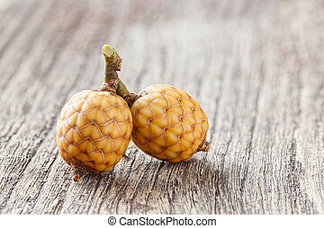Rattan fruit - Close up small bunch of rattan fruit on...
