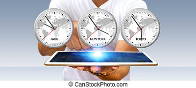Businessman holding time of the world over his digital...