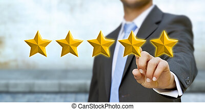Young man rating stars - Young businessman ranking using...