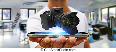 Young man using modern camera - Young man holding modern...