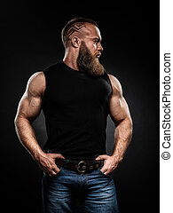 Portrait of handsome bearded man with fashionable hairstyle...