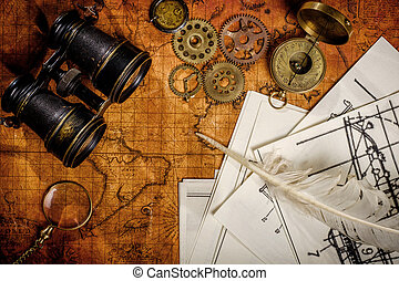 Old vintage retro compass and binoculars on ancient world...