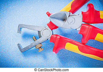 Insulated wire strippers sharp nippers on blue background...