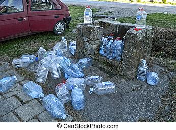 Artesian water - Charging plastic bottles natural arterial...
