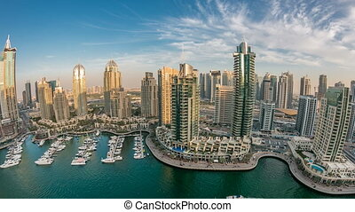 Beautiful aerial top view at sunset timelapse of Dubai Marina in Dubai, UAE