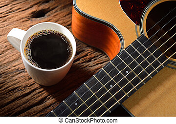 Coffee - A cup of coffee and guitar on wooden table
