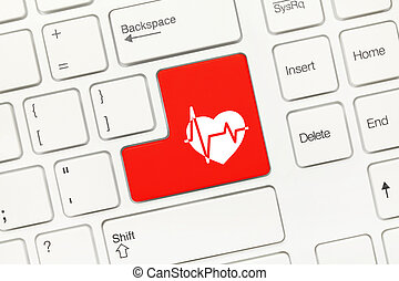 White conceptual keyboard - Red key with cardiology symbol -...