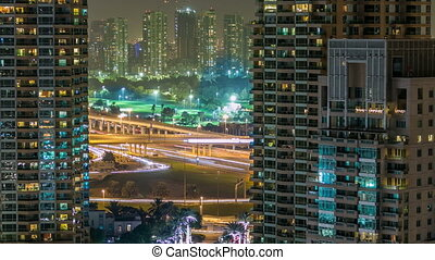 Golf field timelapse from top at night time with traffic on sheikh zayed road.