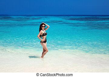 Beautiful sexy bikini girl model sun-tanned On Tropical...