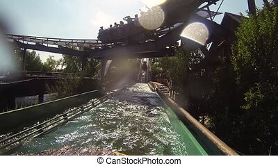 Boat floats on water roller coaster in amusement park Wagon...