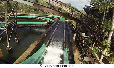 Crush down in water from water roller coaster in amusement park. Spray. Attraction. Entertainment