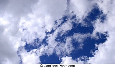 Beautiful white cumulus clouds moving in blue sky - Time...