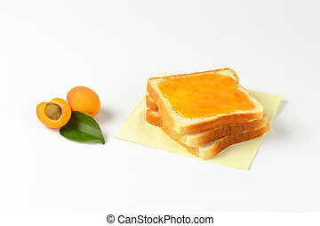 White bread with apricot jam - Slice of white bread, one...