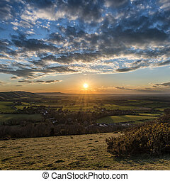 Beautiful landscape image of sunset over countryside...