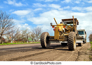 grader is working on road construction