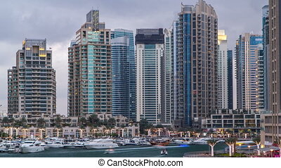View of Dubai Marina Towers and canal in Dubai day to night...