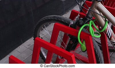 Female Hands Unlocked Bicycle Lock on Parking HD
