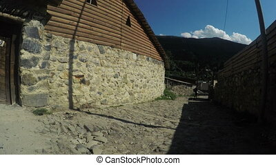 Streets mountain village with girl - Svan village in...