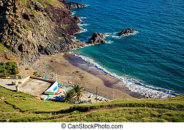 volcanic sand beach Prainha at the eastern part of Madeira,...