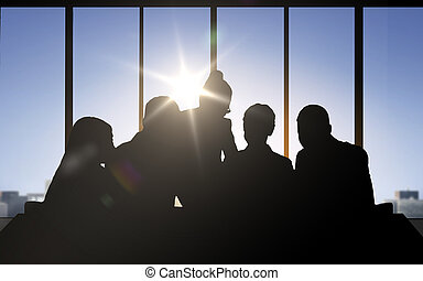 business people silhouettes over office background -...