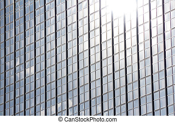 sun reflection in office building facade - sun light...