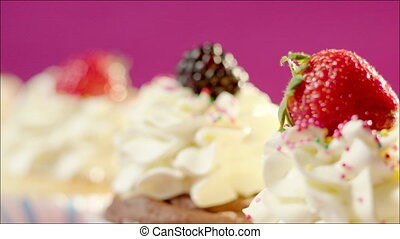 Tasty homemade cup-cakes with berry - Close up shot of three...