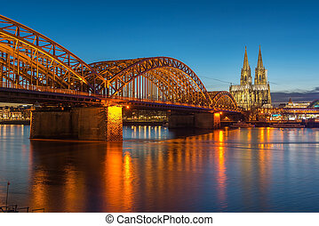 Bridge and the Dom of Cologne at night Cologne, Germany