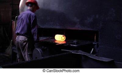 blacksmith under working with steel spring