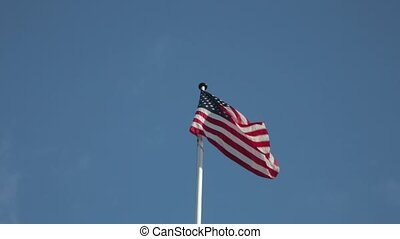 USA Flag Flying at Blue Sky With Clouds