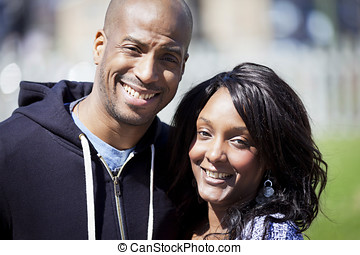Portrait Of A Black Couple Smiling - Front or Back Yard,...