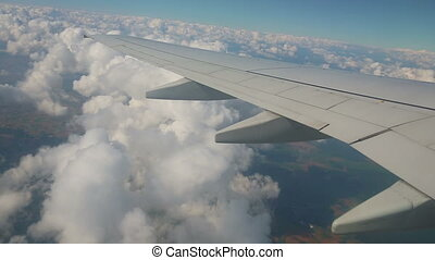 Aerial view from the airplane on cumulus clouds