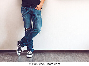 Man's legs - Young fashion man's legs in jeans and sneakers...