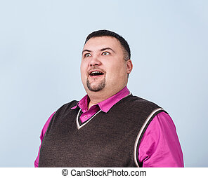 Plump surprised businessman on the blue background