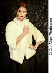 white mink coat - Beautiful young woman wearing mink fur...