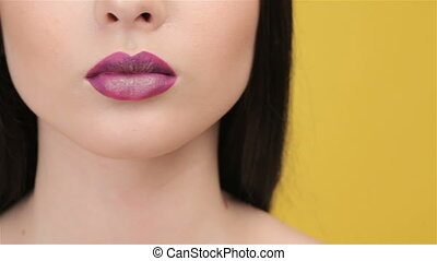 Close up of bright plum lips - Close up of female face with...