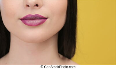 Close up of smilling girl with plum lips - Close up of...