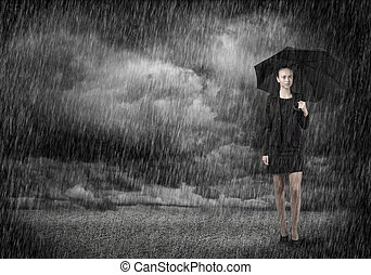 Businesswoman with umbrella - Young businesswoman with...